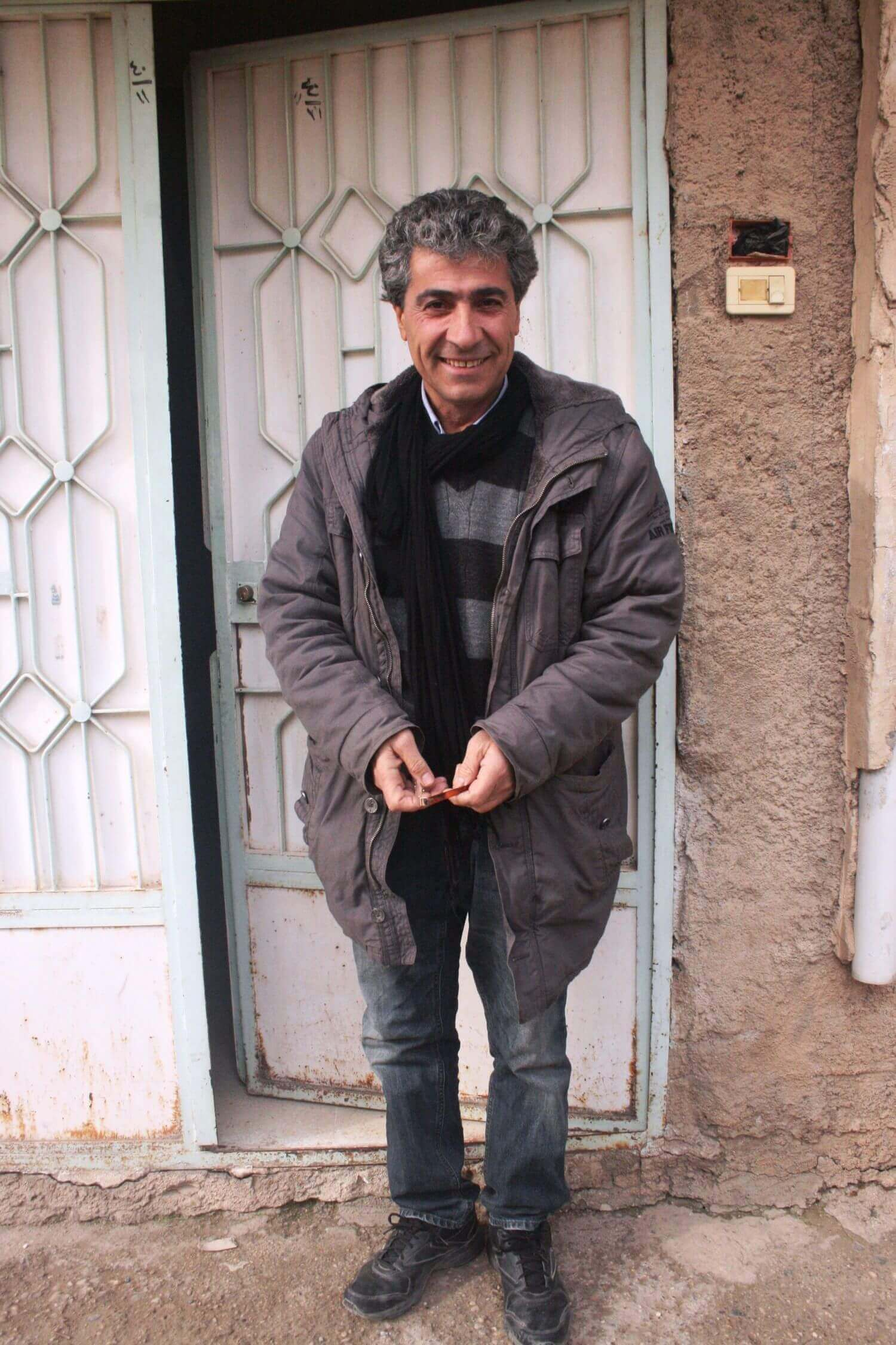 Kurdish poet Taha Xelîl in front of his house Qamishli, February 22, 2014