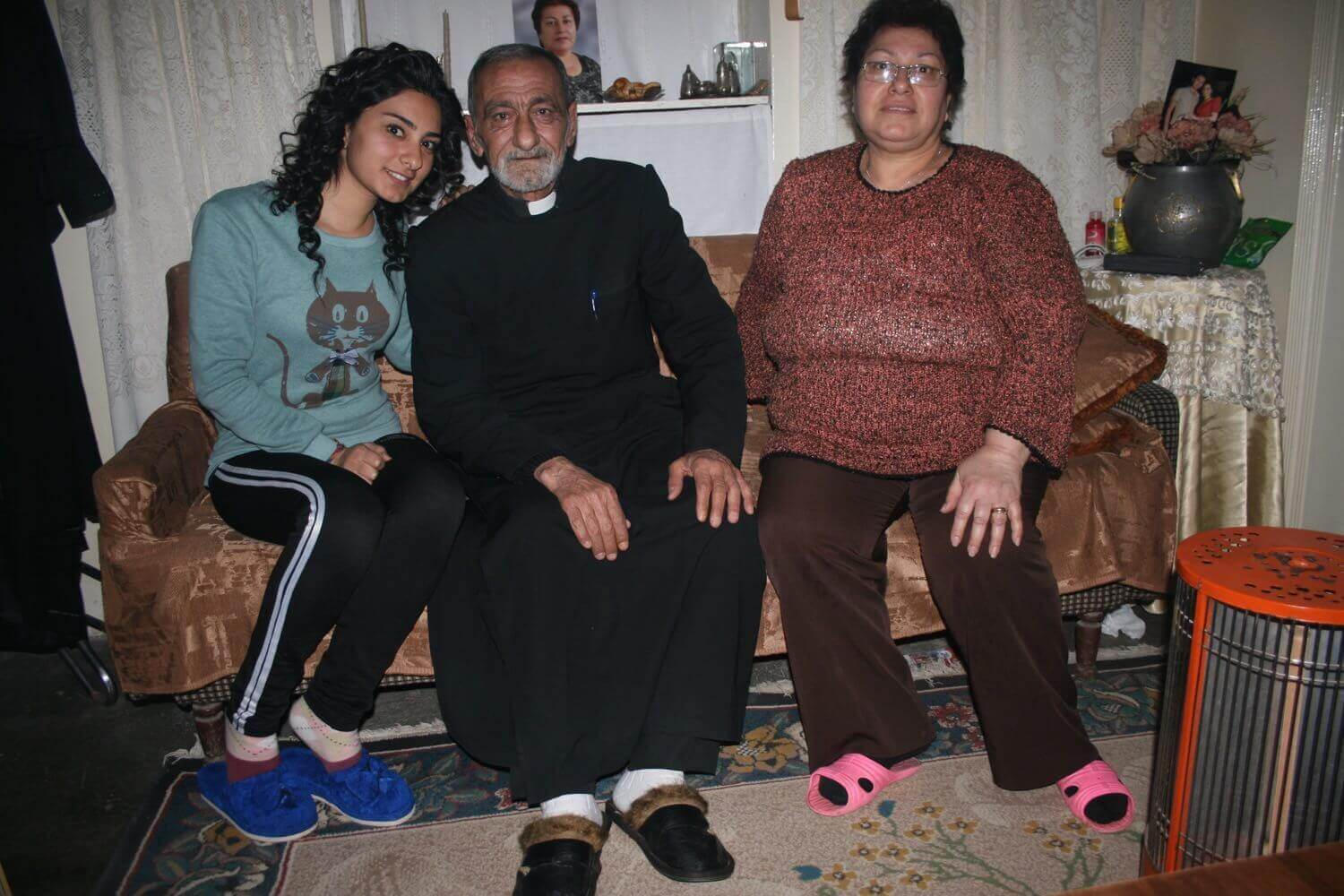 Priest Dajad Akobian with his wife and daughter Talar Dêrik, February 19, 2014
